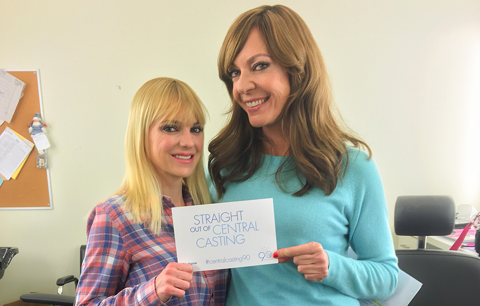 Anna Faris and Allison Janney holding a Straight Out of Central Casting card