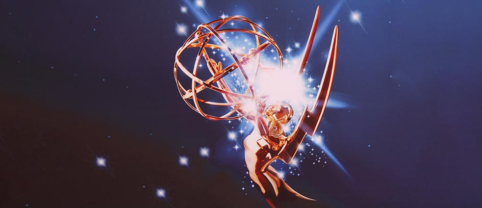 Emmy Awards statue with a light burst on a blue background