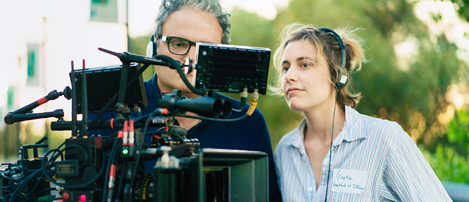 Film director Greta Gerwig and a crew member looking at a monitor