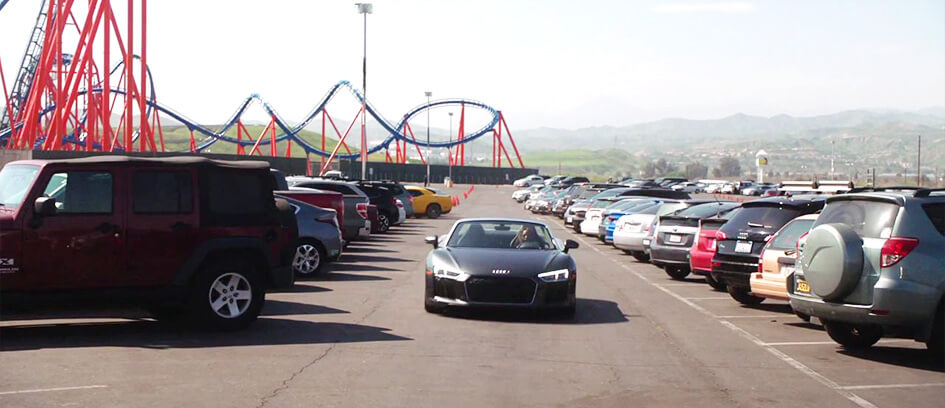 A sports car between two rows of parked cars.