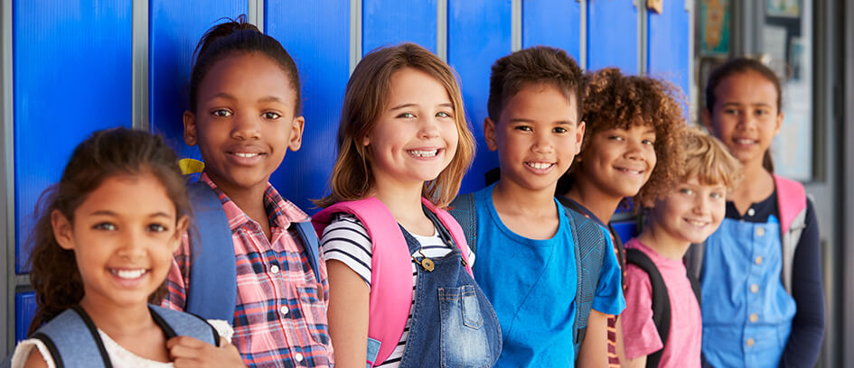 Students posing against school lockers