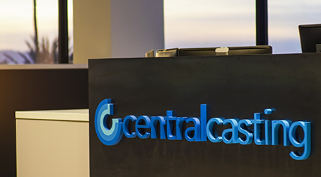 Blue Central Casting logo on the welcome desk in Burbank lobby